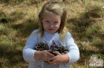 girl-with-pinecones